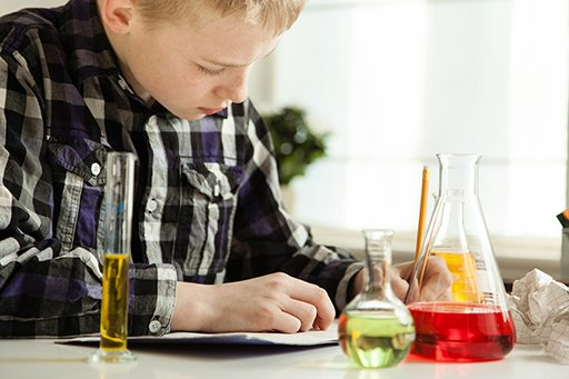 Boy doing science related homework.
